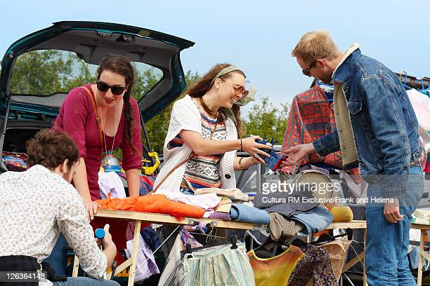 Women selling clothes from car trunk