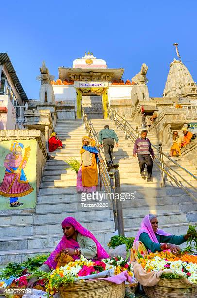 Women selling flowers in front of Indian temple