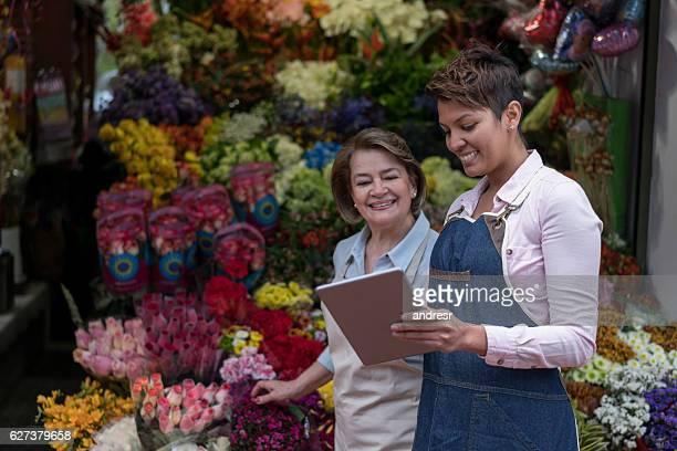 Women selling flowers online