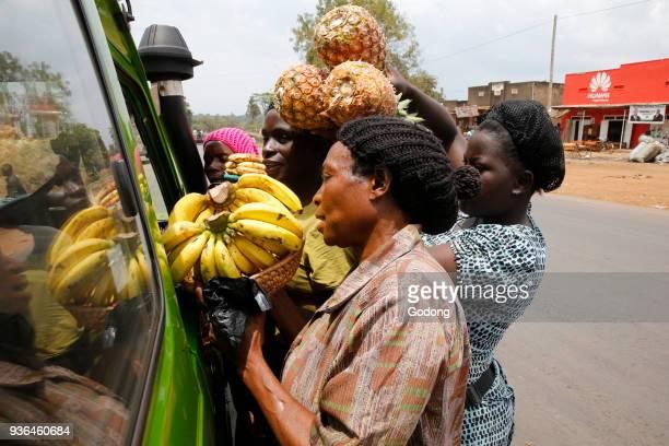 Women selling fruit to travelers Uganda
