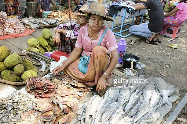 Women selling jackfruit and fish at Danyingone Station on 19th March 2016 in Yangon Myanmar At Danyingone Station one of the Circular Railway's 39...