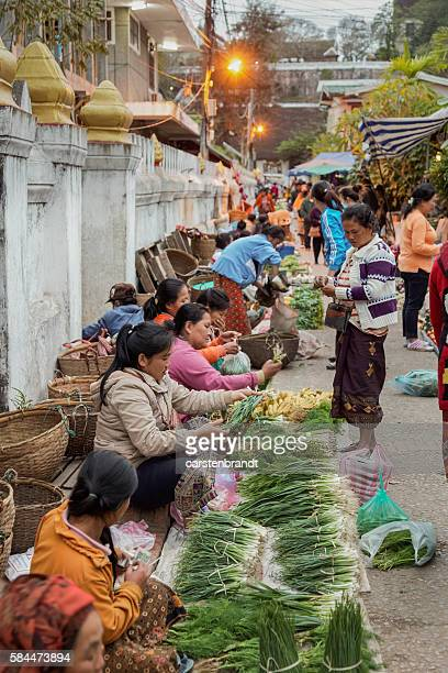 Women selling vegetables in the market in Luang Prabang