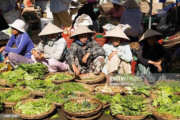 Women selling vegetables on street outside Central Market.