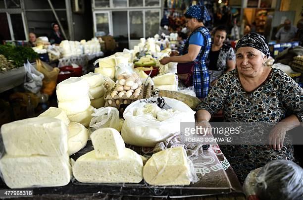 Women sells cheese at the Yashil Bazar market in Baku on June 21 2015 AFP PHOTO / TOBIAS SCHWARZ