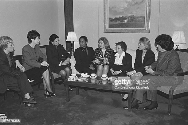 Women senators seated around a coffee table Barbara Boxer Susan Collins Olympia Snowe Carol MoseleyBraun Kay Bailey Hutchison Barbara Mikulski Mary...