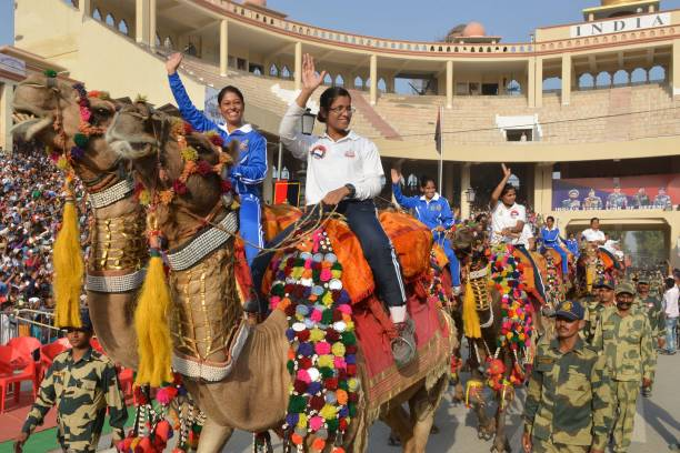 Women serving in the Indian Border Security Force and Indian Air Force take part in a closing ceremony of the Camel Safari expedition at the...