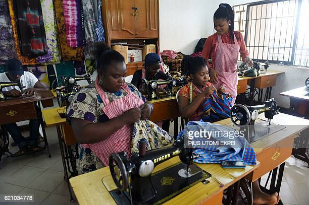 Women sew clothes at Idia Renaissance nongovernmental organisation in Benincity Edo State midwest Nigeria on October 21 2016 In 2015000 migrants...