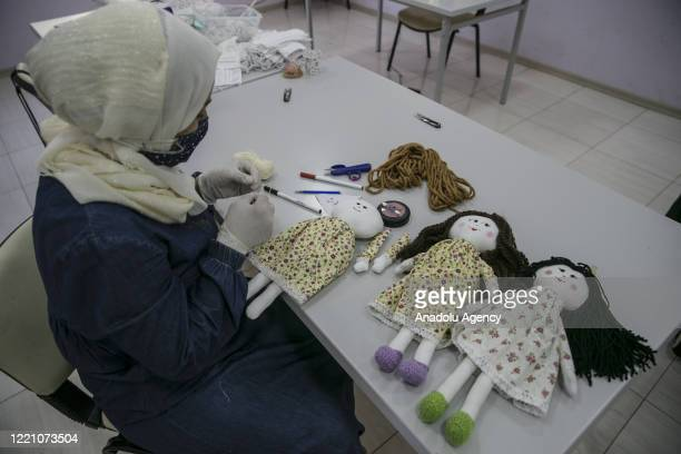 Women sew knitted toys as a gift for Syrian orphan children living in Turkey and in the refugee camps in Syria as part of a project launched within...