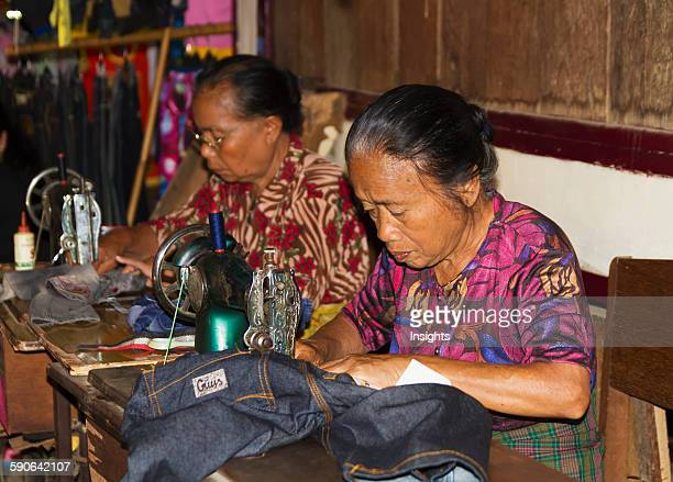 Women sewing at the Bolu market Rantepao Toraja Land South Sulawesi Indonesia
