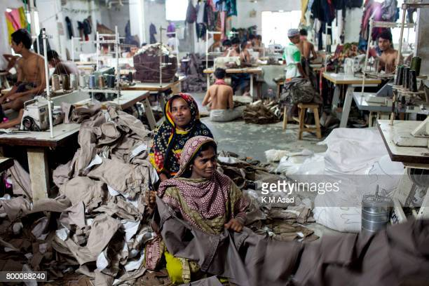 SADARGHAT DHAKA BANGLADESH Women sews a cloth in a local garment shop in Dhaka Bangladesh World Day Against Child Labor was observed on 12 June...