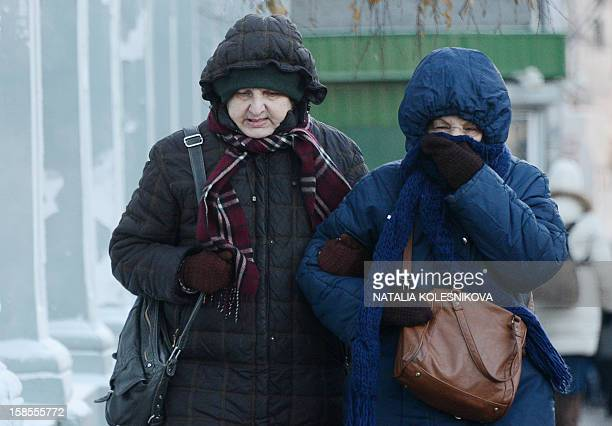 KOLESNIKOVA Women shield their face against the freezing outdoors in Moscow on December 19 2012 A cold wave of weather hit this week the Russian...