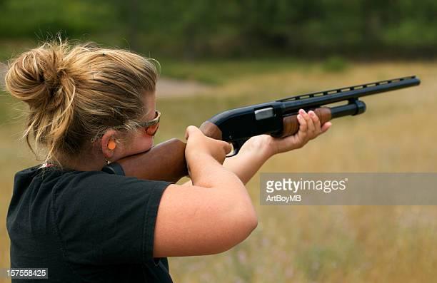 Women shooting a gun
