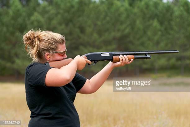 women shooting shotgun - shotgun stock pictures, royalty-free photos & images