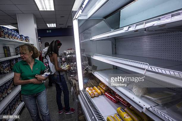 Women shop at a privatesector grocery store in Caracas Venezuela on Wednesday Feb 18 2015 In Venezuela which has the world's largest oil reserves...