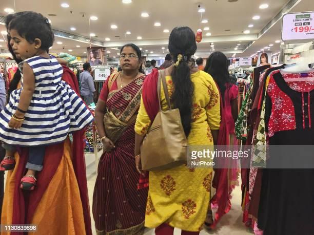Women shop for churidars and ladies suits in Thiruvananthapuram, Kerala, India.
