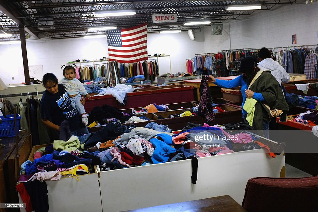 Women shop for clothes at a thrift store on October 20, 2011 in Reading, Pennsylvania. Reading, a city that once boasted numerous industries and the nation's largest railroad company, has recently been named America's poorest city with residents over 65,000. According to new census data, 41.3 percent of people live below the poverty line in Reading. Reading has about 90,000 residents, many of whom are recent Hispanic arrivals who have moved from larger eastern cities over the past decade. While a manufacturing base offering well paying jobs still exists in Reading, many companies like Hershey, Stanley Tool and Dana Systems have either moved elsewhere in the United States or to Mexico in search of cheaper labor. The number of people living in poverty in America, 46.2 million, is now at its highest level for the 52 years the Census Bureau has been keeping records.