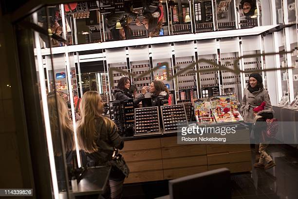 Women shop for cosmetics at a shop in the Main Concourse of the Grand Central Terminal February 4 2011 in New York