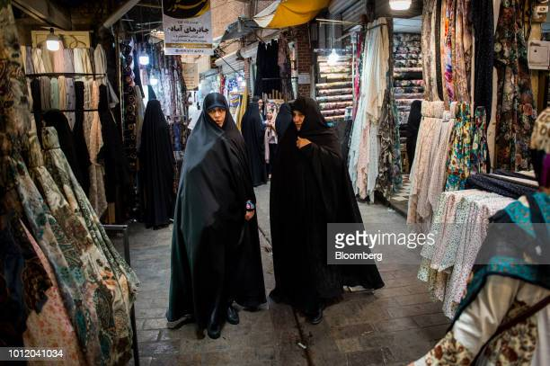 Women shop for fabrics inside the Grand Bazaar in Tehran Iran on Monday Aug 6 2018 Irans central bank acting on the eve of US sanctions scrapped most...