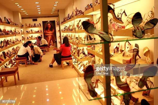 Women shop for shoes April 11 2008 in Bangalore India Many residents work for multinational cooperations and the economy is booming New construction...