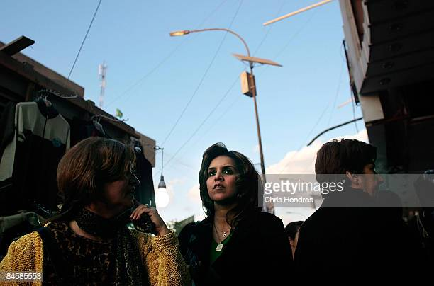 Women shop in the garment district of the fashionable Karradah neighborhood February 2 2009 in central Baghdad Iraq Baghdad's streets have remained...