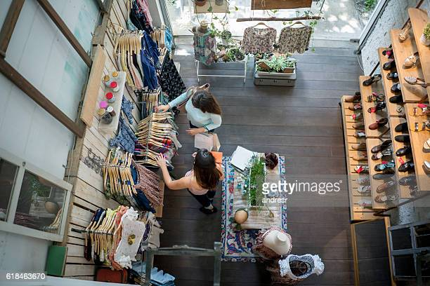 women shopping at a clothing store - shopping centre stock photos and pictures