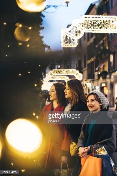women shopping during winter sales in rome, italy - natale di roma foto e immagini stock