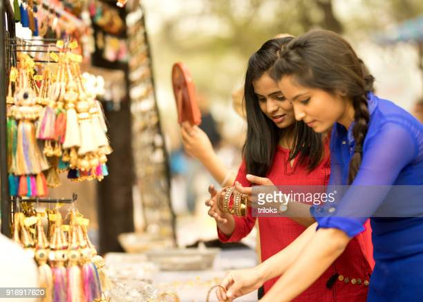 women shopping for bangles at street market stall - bangle stock pictures, royalty-free photos & images