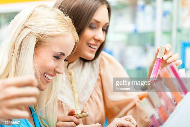Women shopping for make-up products