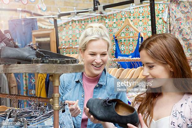 Women shopping for shoes in  vintage shop.