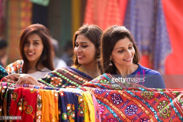 women shopping for souvenir at street market - shawl stock pictures, royalty-free photos & images