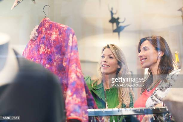 Women shopping in clothing retail store