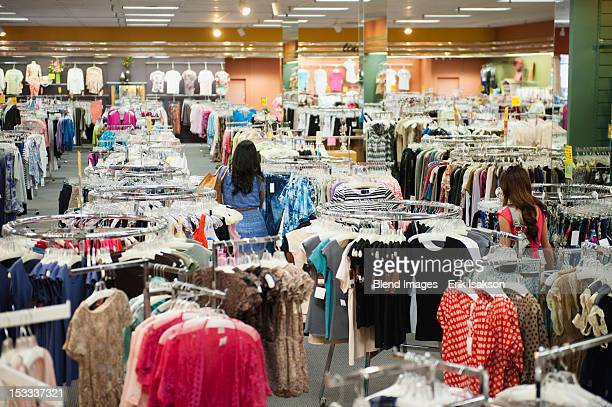 women shopping in clothing store - womenswear stock pictures, royalty-free photos & images