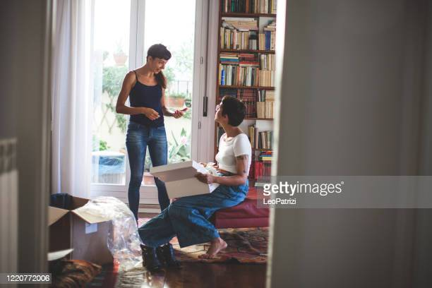 women shopping online during pandemic covid19 - unboxing stock pictures, royalty-free photos & images