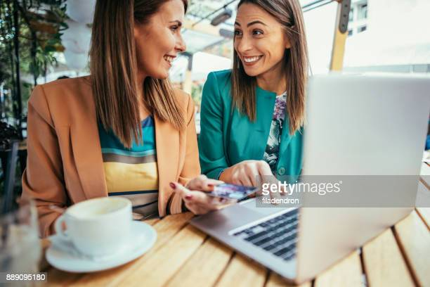 women shopping online - money transfer stock pictures, royalty-free photos & images