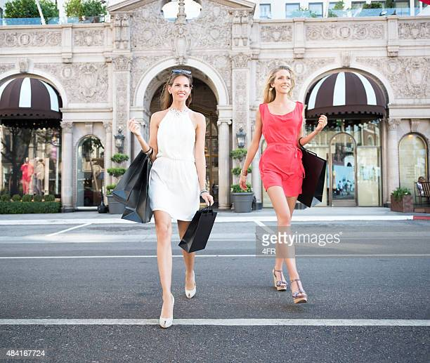 women shopping, rodeo drive, los angeles - beverly hills california stock pictures, royalty-free photos & images