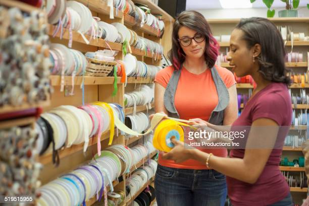 Women shopping together in fabric store