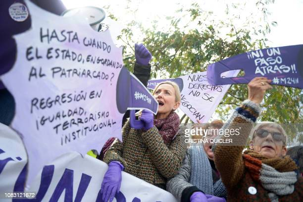 Women shout during a Women's demonstration against the farright party VOX on January 15 2019 in front of Andalusia's regional parliament in Sevilla...