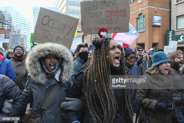 Women shout slogans against racism as thousands of Canadians in a massive protest against President Trump's travel ban on Muslims during the National...