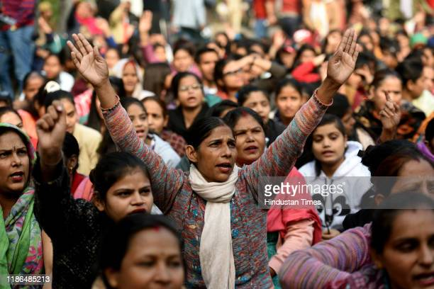 Women shout slogans as they participate in a peaceful demonstration during Delhi Commission for Women chairperson Swati Maliwal's second day of...