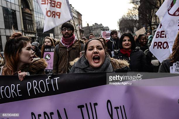 Women shout slogans during a protest held in solidarity with the Washington DC Women's March in Dublin Ireland on January 21 2017