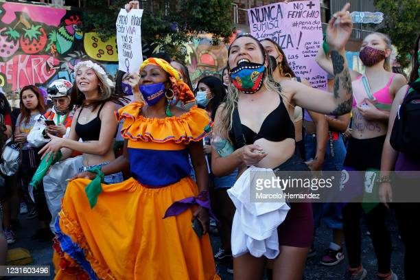 Women shout slogans during a rally for legal abortion and other issues as part of the International Women's Day on March 8, 2021 in Santiago, Chile.