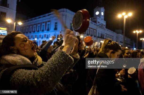 Women shouting and making noise hitting pots and pans protesting in Sol Square to mark the start of the International Women's Day