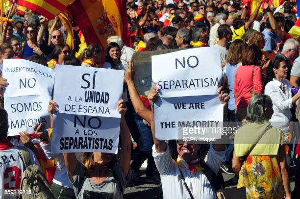 Women show banners against the independence of Catalonia during the demonstration in favour of the unity of Spain Thousands of people protested on...