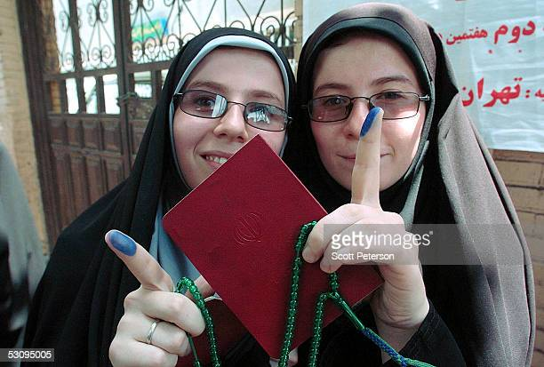 Women show off their inkstained fingers after casting their ballots on June 17 2005 in Tehran Iran Disillusioned with eight years of ineffective rule...