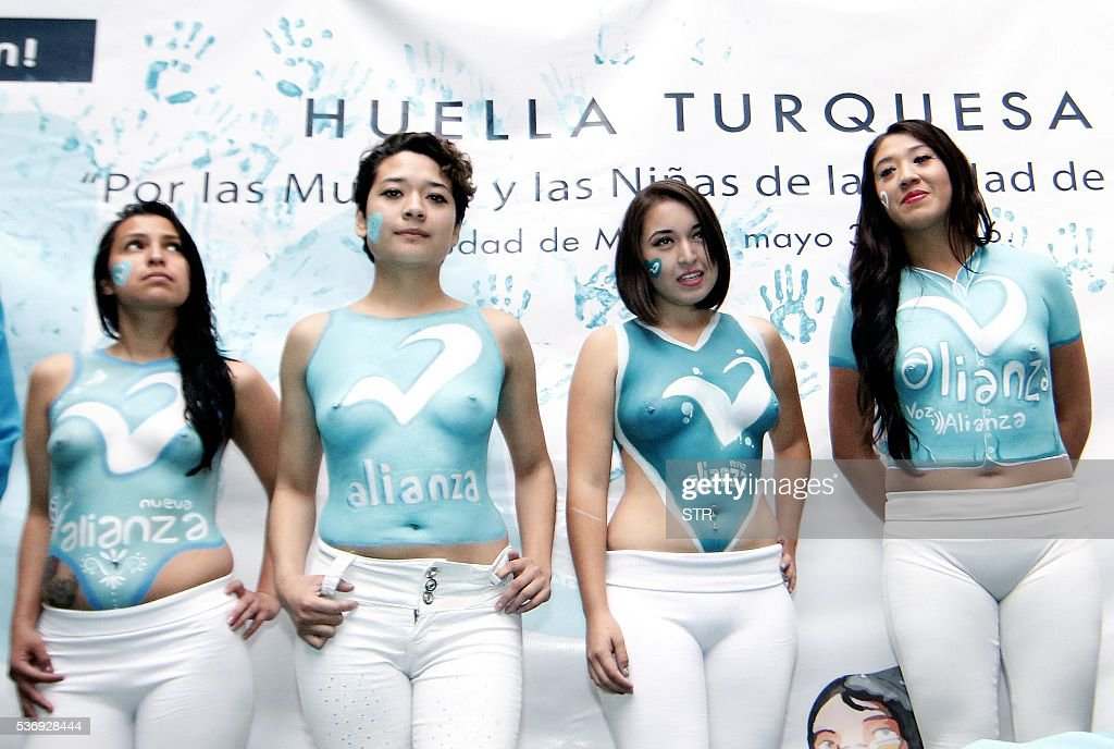 Women show their bodypaintings during the closing campaign