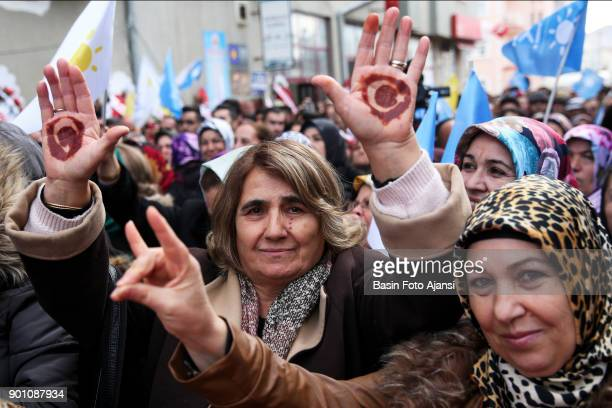 Women show their hands to represent a Turkish flag designed with henna at rally in Yozgat by Iyi Parti