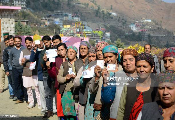 Women showing their voting cards before cast their votes for Himachal assembly elections at Theog on November 9 2017 in Shimla India A total of 337...