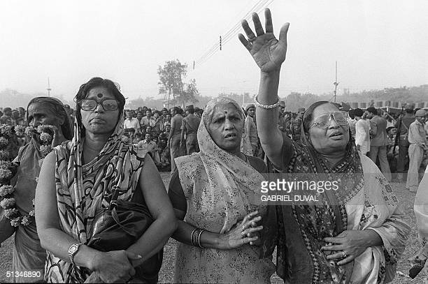 Women shown in file photo dated 03 November 1984 assisting Indira Gandhi's cremation in New Delhi