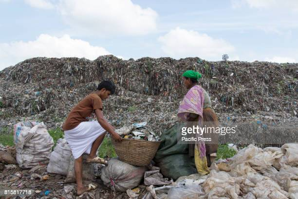 Women sift through mountains of rubbish searching for anything reusable or recyclable they can sell although it will earn them less than $3 a day...