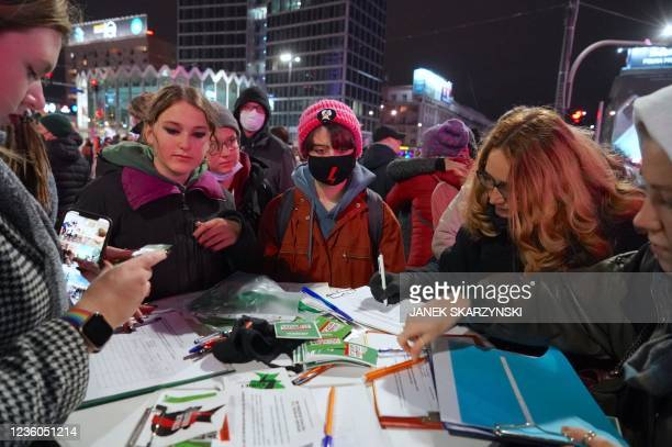 Women sign a petition during a demonstration demanding the restoring of the right to abortion in Poland on October 22, 2021 in Warsaw, marking the...